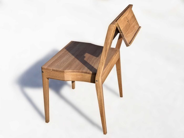 Stackable church chair ZOE made of oak wood with foldable Bible holder.